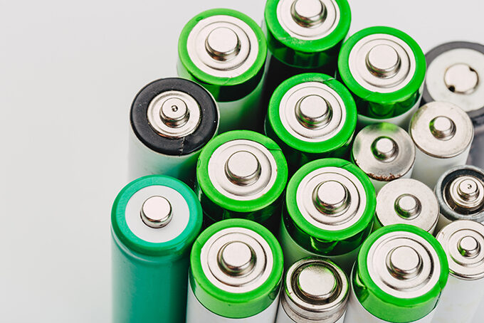 Many,new,and,used,alkaline,batteries,type,aa,on,a